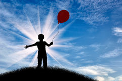 Silhouette of boy on hill with balloon day Royalty Free Stock Photo