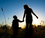 Silhouette of a boy and his mother Royalty Free Stock Photography