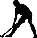 Silhouette of boy hockey player playing corner ball Royalty Free Stock Image