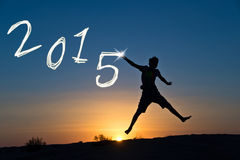 2015 Silhouette of a boy jumping Royalty Free Stock Images