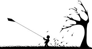 Boy with a kite in autumn. Silhouette of a boy with a kite on a stromy autumn day Royalty Free Stock Images