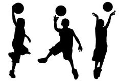 Silhouette of boy playing basketball Stock Photos
