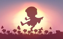 Silhouette of boy playing in the field Royalty Free Stock Image