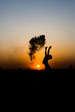 Silhouette of a boy playing. Silhouette of a boy playing sand on sunset Royalty Free Stock Image