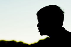 Silhouette of boy's profile Royalty Free Stock Photos