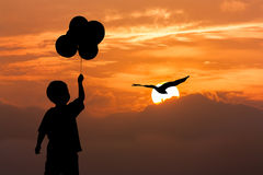 Silhouette of boy stand holding bubble Stock Images