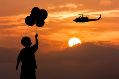 Silhouette of boy stand holding bubble Royalty Free Stock Photo