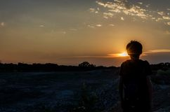 Silhouette of a Boy During Sunset stock image