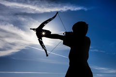 Silhouette of boy and toy bow. Royalty Free Stock Image