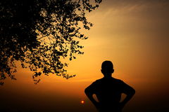 Silhouette of a boy watching at sunset Royalty Free Stock Photo