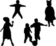 Silhouette of boys and girls. Vector silhouettes of boys playing soccer and girls posing Stock Photo