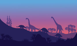 Silhouette of Brachiosaurus and Ankylosaurus Royalty Free Stock Photo
