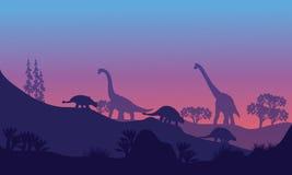 Silhouette of Brachiosaurus and Ankylosaurus Royalty Free Stock Photo