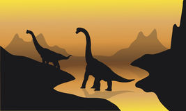 Silhouette of brachiosaurus in river Stock Image