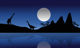 Silhouette of Brachiosaurus in riverbank Stock Images