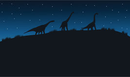 Silhouette of brachiosaurus with star Royalty Free Stock Images