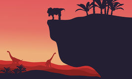 Silhouette of Brachiosaurus and T-Rex with red backgrounds Royalty Free Stock Photography