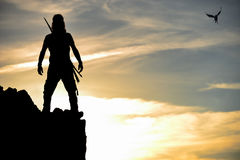 Silhouette of the brave man on the cliff. Mountaineering activities; silhouette of the brave man on the cliff Royalty Free Stock Photo