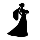Silhouette of a bride with a bouquet Stock Images