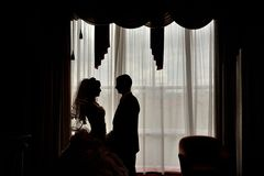 Silhouette of a bride and groom Stock Photography