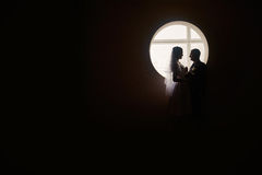 Silhouette of a bride and groom on the background of the window.  Stock Images
