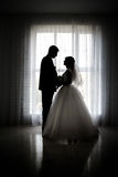 Silhouette of bride and groom Stock Photos