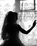 Silhouette of the bride weared in dress Stock Image