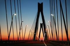 The silhouette of the bridge against the evening sky stock image