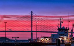 Silhouette of a Bridge Under Red Clouds and Blue Sky Taken during Night Time Stock Photo