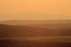 Silhouette of the Brocken hill into evening atmosphere Royalty Free Stock Images