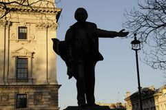 Silhouette of the bronze sculpture of David Lloyd George. An outdoor bronze sculpture of former British Prime Minister David Lloyd George by Glynn Williams Stock Images