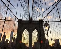 Silhouette of Brooklyn bridge and buildings with sunset sky Royalty Free Stock Images