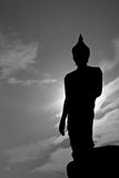 Silhouette of buddha Stock Photography