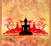 Silhouette of a Buddha,Asian landscape in the background Royalty Free Stock Image