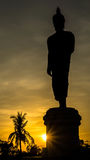 Silhouette Buddha. Isolated on sunset sky background Stock Image