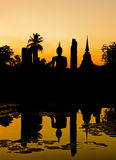 Silhouette of Buddha and pagoda Royalty Free Stock Photos
