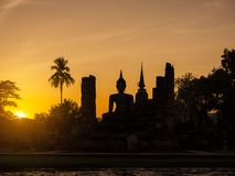 Silhouette Buddha Pagoda landscape sunset at Sukhothai Historica Stock Photos
