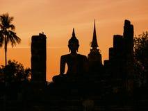 Silhouette Buddha Pagoda landscape sunset at Sukhothai Historical Park Royalty Free Stock Image