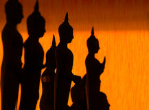 Silhouette of Buddha pouring water to Buddha statue in Songkran Royalty Free Stock Photo