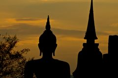 Silhouette of buddha statue Stock Photo