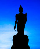 Silhouette of Buddha statue Stock Photos