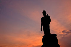 Silhouette of Buddha statue with ray light at twilight Stock Photos