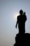 Silhouette buddha statue. On sky background royalty free stock photography