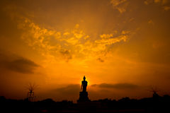 Silhouette Buddha statue in the sunset Royalty Free Stock Images