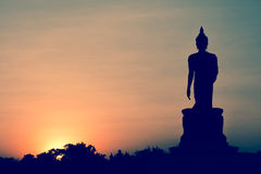 Silhouette of Buddha statue Stock Image