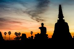 Silhouette of buddha statue Stock Images
