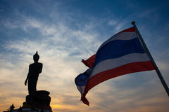 Silhouette of Buddha statue and Thailand flag at Phutthamonthon, Royalty Free Stock Photo