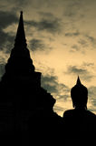 Silhouette of buddha staue Stock Photos