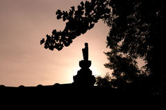 Silhouette of buddhist statue Stock Photos