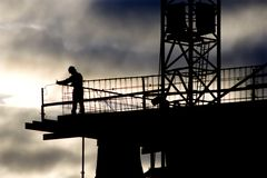 Silhouette of builder Stock Image